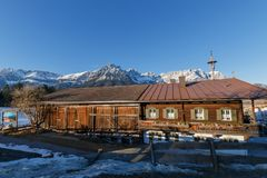 Old farmhouse in front of Kaiser Mountains, Austria Royalty Free Stock Photography