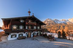 Old farmhouse in front of Kaiser Mountains, Austria Royalty Free Stock Images