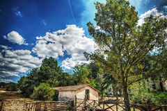 Old farmhouse under a cloudy sky in Sardinian countryside Stock Image
