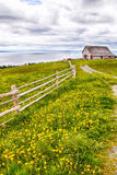 Old Farmhouse and Wood Fence Stock Photography