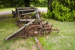 Old farming equipement. Vintage farm equipment beside a country road Stock Photo