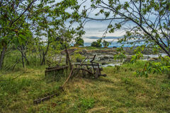 Old farming equipement. Vintage farm equipment in a provincial  park Royalty Free Stock Image