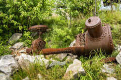 Old farming equipement. Vintage farm equipment in a provincial  park Stock Photos