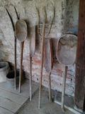 Old farming tools. Old wooden farming tools placed on a wall Royalty Free Stock Photography
