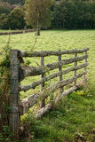 Old Farmland Tree Trunks Wood Gate in Farm Field Royalty Free Stock Image