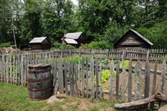 Old farmstead. With garden fence and barrel royalty free stock photo