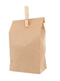 Old-fashied lunch bag with wooden clothes pin. On white background Royalty Free Stock Photos
