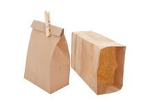 Old-fashied lunch bag with wooden clothes pin. Old-fashioned lunch bag with wooden clothes pin on white background Stock Images