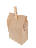 Old-fashied lunch bag with wooden clothes pin 2. On white background Stock Image