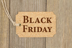 Old fashion Black Friday gift tag. A retro cork gift tag on weathered wood background with text Black Friday Stock Photography