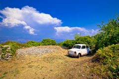 Old fashion car wreck in nature in Skrip vilage on Brac island. Dalmatia, Croatia Stock Photo