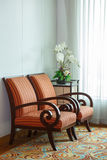 Old fashion chair near the window Stock Image