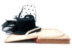 Old fashion. Composition with vintage hat pearls and book isolated on white Royalty Free Stock Image