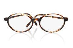 Old fashion eyeglasses. Old fashion plastic frame eyeglasses on white background Stock Image