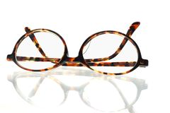 Old fashion eyeglasses. Old fashion plastic frame eyeglasses on white background Royalty Free Stock Photography