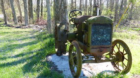 Old Fashion Farm Tractor. Long time ago. Been repurposed as a lawn ornament Royalty Free Stock Photography