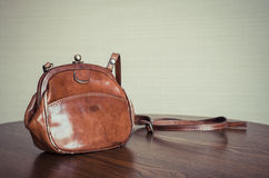 Old fashion female's leather bag - vintage style effect picture Royalty Free Stock Photography