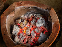 Old fashion firepot with coal stock image