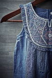 Old Fashion Girl Dress on a Clothes Hanger royalty free stock photos