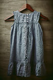 Old Fashion Girl Dress on a Clothes Hanger royalty free stock photo