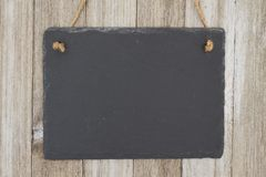 Old fashion hanging chalkboard background. A retro chalkboard on weathered wood background with copy space for your message Stock Photography