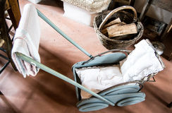 Old fashion Italian baby stroller in a museum of ancient crafts in the city of Valli del Pasubio, Italy Stock Photography