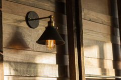 Old-fashion lamp hanging on wooden wall Stock Photo