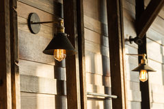 Old-fashion lamp hanging on wooden wall Stock Image