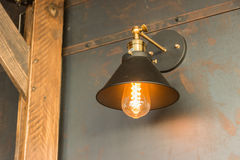 Old-fashion lamp hanging on wooden wall Royalty Free Stock Photography