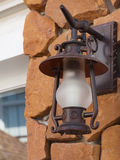 Old-fashion lamp on sand stone wall Royalty Free Stock Image
