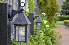 Old fashion lantern lights near path. Focus on first old fashion lantern lights near path Stock Image