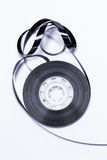 Old fashion magnetic audio tape. Over white bacground Royalty Free Stock Photos