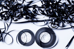 Old fashion magnetic audio tape. Over white bacground Stock Image