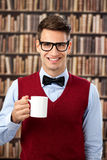Old-fashion man with coffee. Smiling man old-fashion dressed drinking coffee Royalty Free Stock Photo