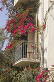 Old-Fashion Mediterranian Balkony. With pink Flowers Royalty Free Stock Photography