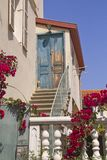 Old-Fashion Mediterranian House Entrance. Decorated with pink Flowers Stock Image