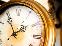 Old fashion metal wall clocks stock image