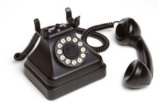Old Fashion Phone. Isolated old fashion black phone royalty free stock image