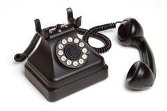 Old Fashion Phone. Isolated old fashion black phone Royalty Free Stock Image