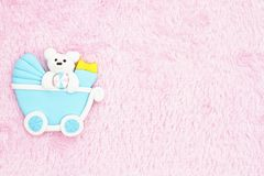 Old fashion pink baby background. With a baby carriage on pink material stock image