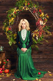 Old fashion retro style woman. Beautiful blonde girl in studio with autumn decoration Stock Photography