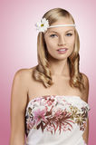 Old fashion shot of blond girl with daisy. Sweet portrait of an attractive young blond girl with an old fashion look with a daisy in the hair and a flowered Stock Photos