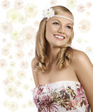 Old fashion shot of blond girl with daisy smiling. Sweet portrait of an attractive young blond girl with an old fashion look with a daisy in the hair and a Stock Photography