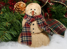 Old Fashion snowman and Christ. A wooden old fashioned snowman with scarf Royalty Free Stock Image