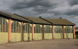 Old Fashion Storage Buildings. Old romantic storage building with huge doors and glass windows royalty free stock photography