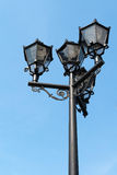 Old fashion street lamp. With modern lighting system against a bright blue sky background Stock Photo