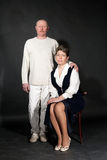 Old-fashion studio portrait of mid-aged couple Royalty Free Stock Images