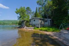 Old Wood Summer Cottage on Lake Stock Photos