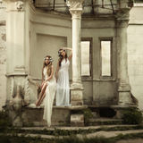Old fashion. Two young attractive beautiful blonde women in greek style.  grain and texturer added Stock Photography