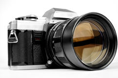 Old-fashion vintage retro camera with big lens isolated on white Royalty Free Stock Image